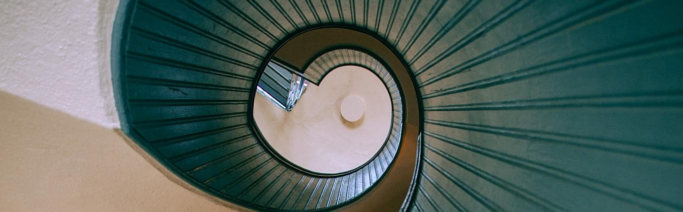 Looking down a blue spiral staircase