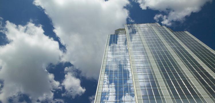 skyscraper with blue clouds