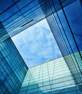 Blue sky through building