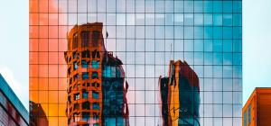 Tall glass building with orange reflection
